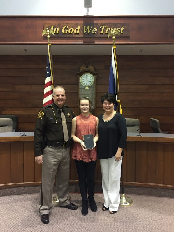 sheriff with wife and daughter.jpg