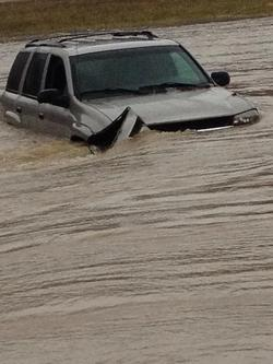 vehicle in flood water.jpg