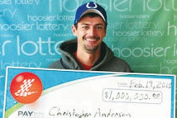 Christopher Anderson picks up winnings.jpg