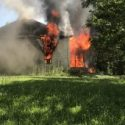 Columbus woman recused from burning home